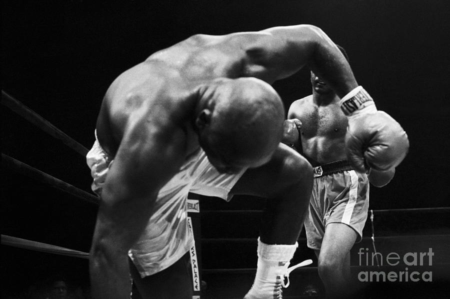 Frazier Falls Into Camera, Foreman Punch Photograph by Bettmann