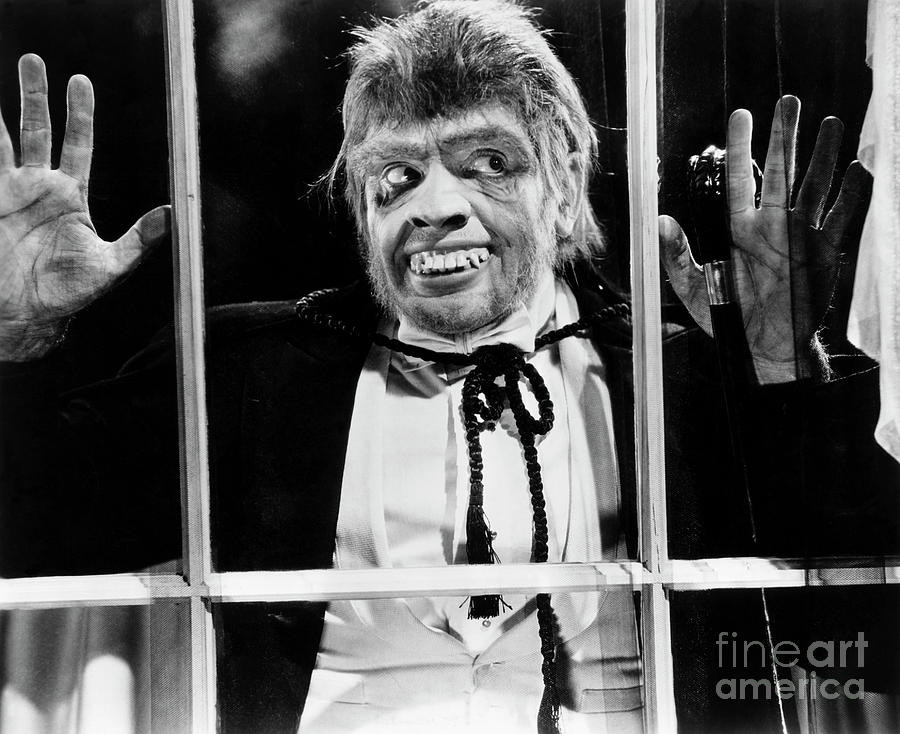 Frederic March At Window In Dr. Jekyll Photograph by Bettmann