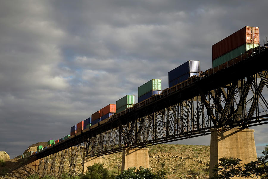 Freight Train In The Hills Photograph by Vallariee