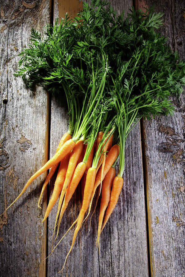 Fresh Carrots On Rustic Wood Photograph by Jurgen Wiesler