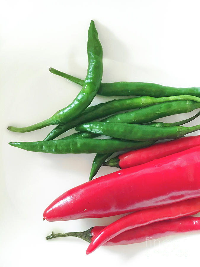 Fresh chilli peppers by Tom Gowanlock