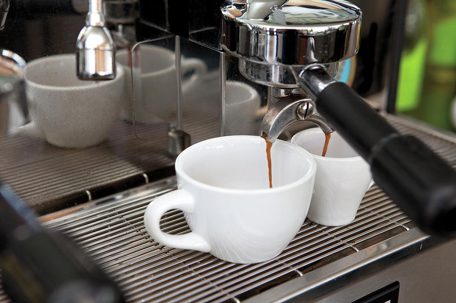 Fresh Espresso Pouring From Machine Photograph by Smith Collection