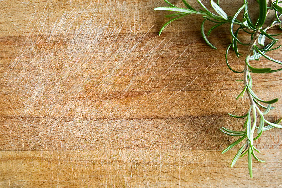 Fresh Rosemary On A Wood Chopping Board Photograph by Infrontphoto