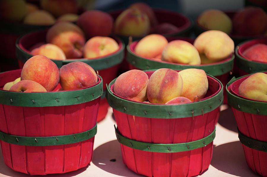 Fresh Texas Peaches In Colorful Baskets Photograph by Txphotoblog - Randy Ennis