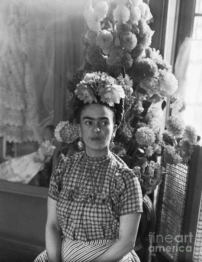 Frida Kahlo Sitting Underneath Flower Photograph by Bettmann