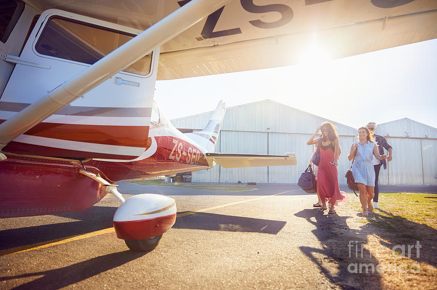 Adventure Photograph - Friends Walking Toward Small Airplane by Caia Image/science Photo Library