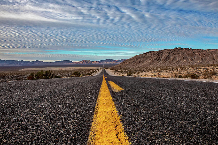 Froim Nevada to California - The Down Low by Peter Tellone