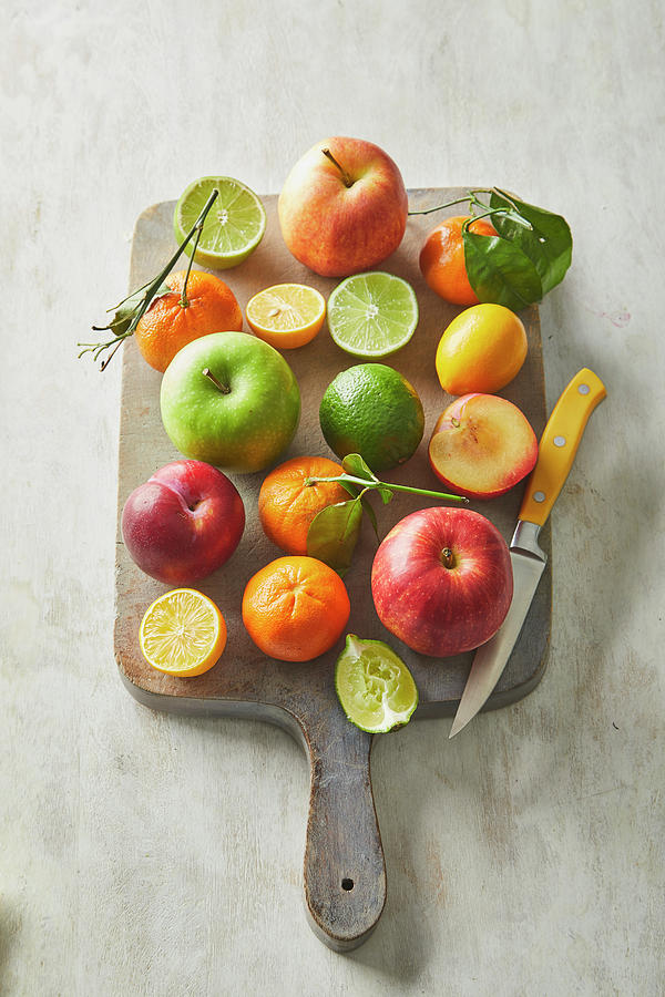 Fruit on a cutting  board by Cuisine at Home