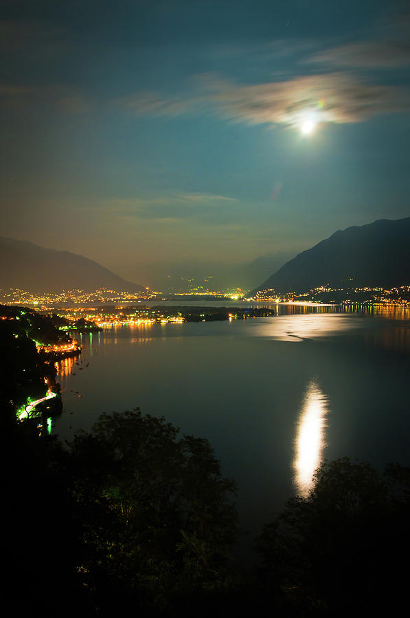 Full Moon Over Lake Maggiore In Photograph by Assalve