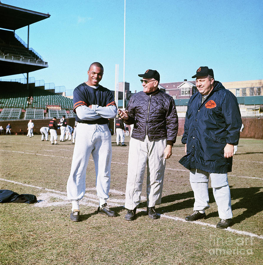 Gale Sayers With Coaches Photograph by Bettmann