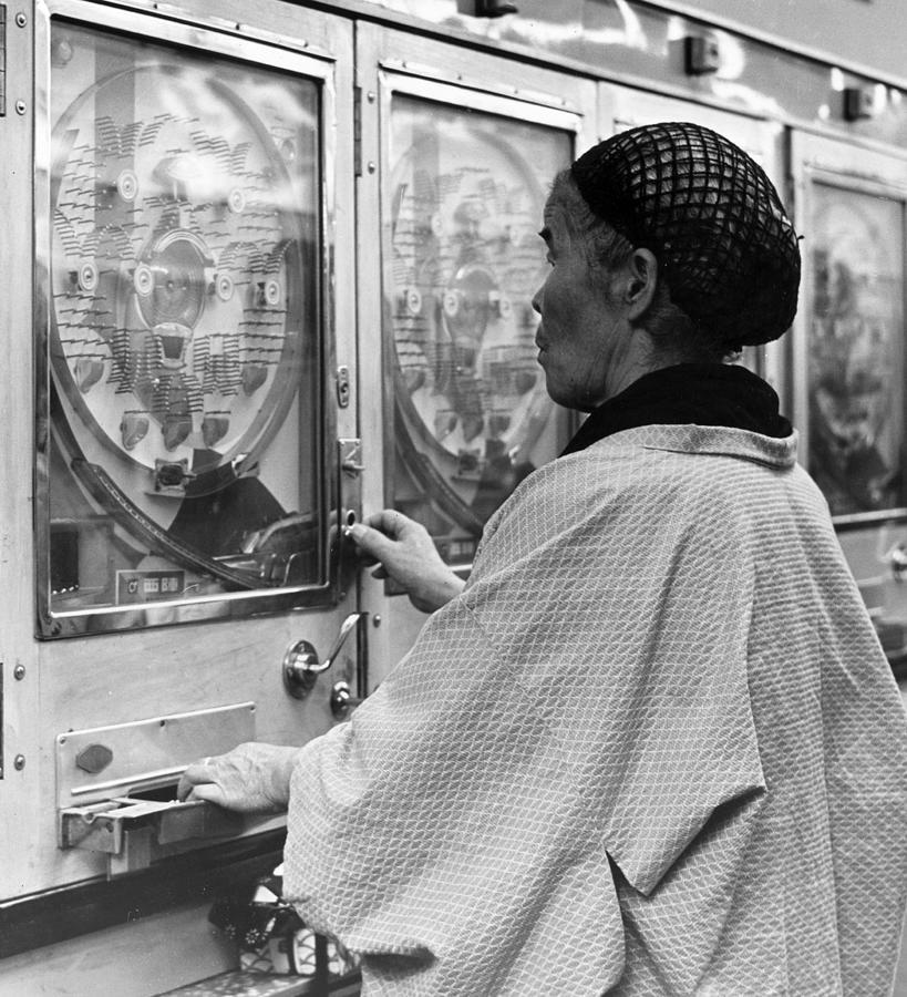 Gambling Granny Photograph by Three Lions