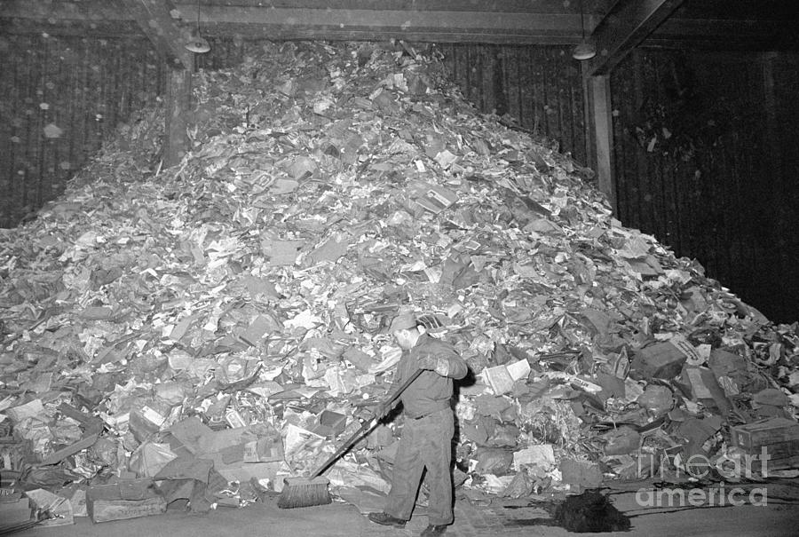 Garbage Collector Sweeping Huge Pile Photograph by Bettmann
