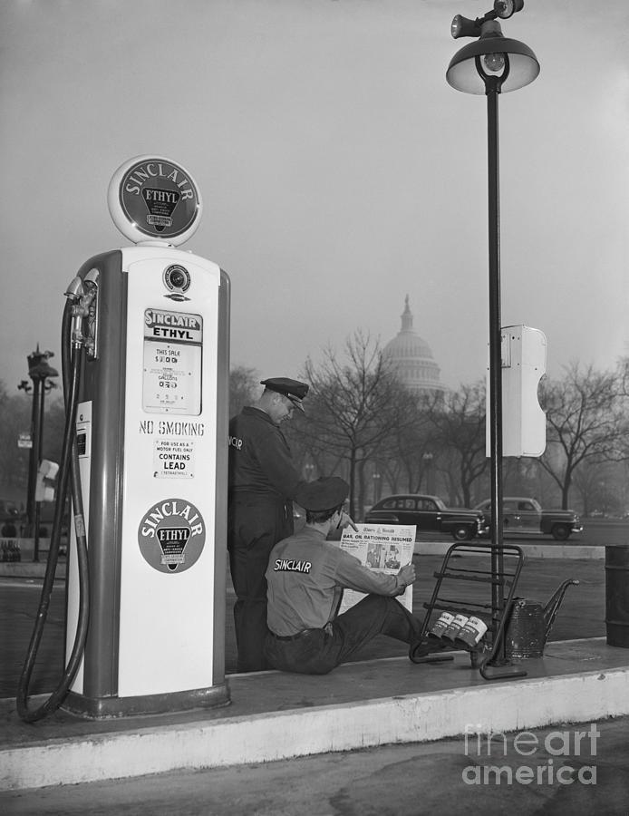 Gas Attendant Reading Rations Photograph by Bettmann