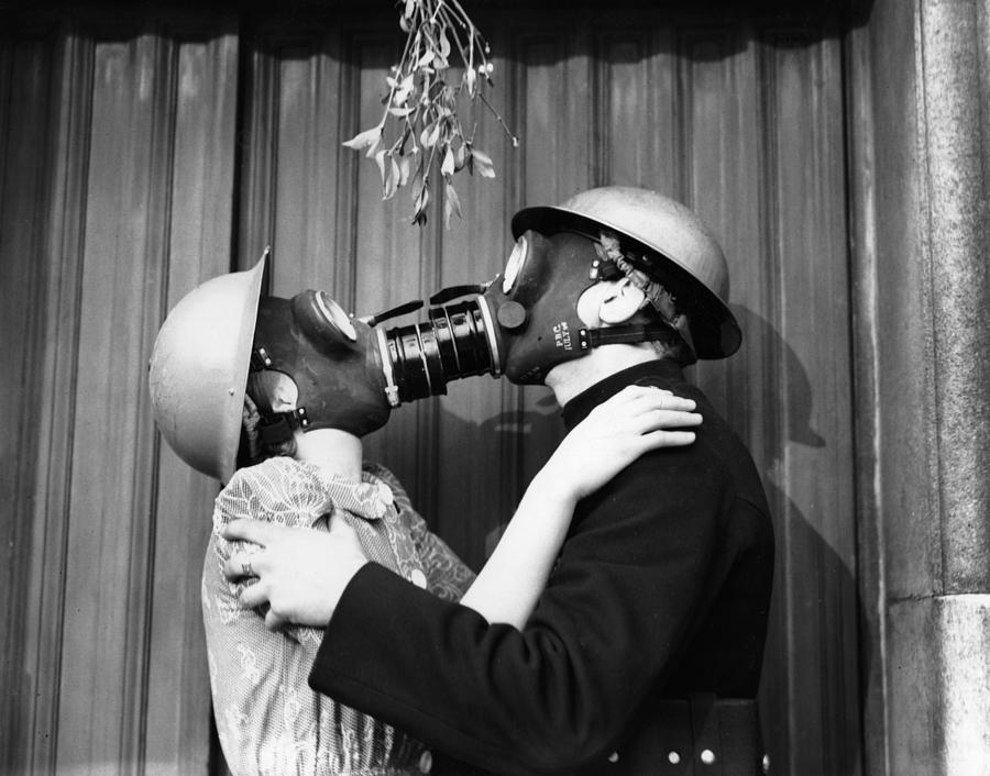 Gas Mask Kiss Photograph by Fox Photos