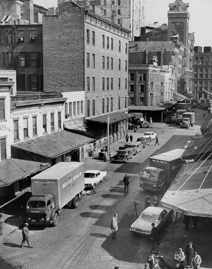 General View Of Moving Vans Loading Up Photograph by New York Daily News Archive