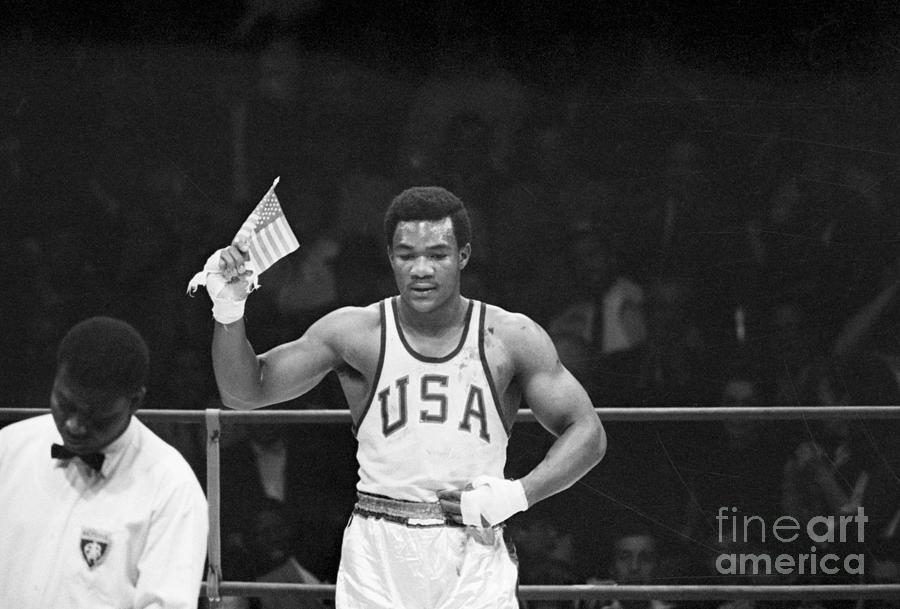 George Foreman Waves Us Flag At Olympic Photograph by Bettmann
