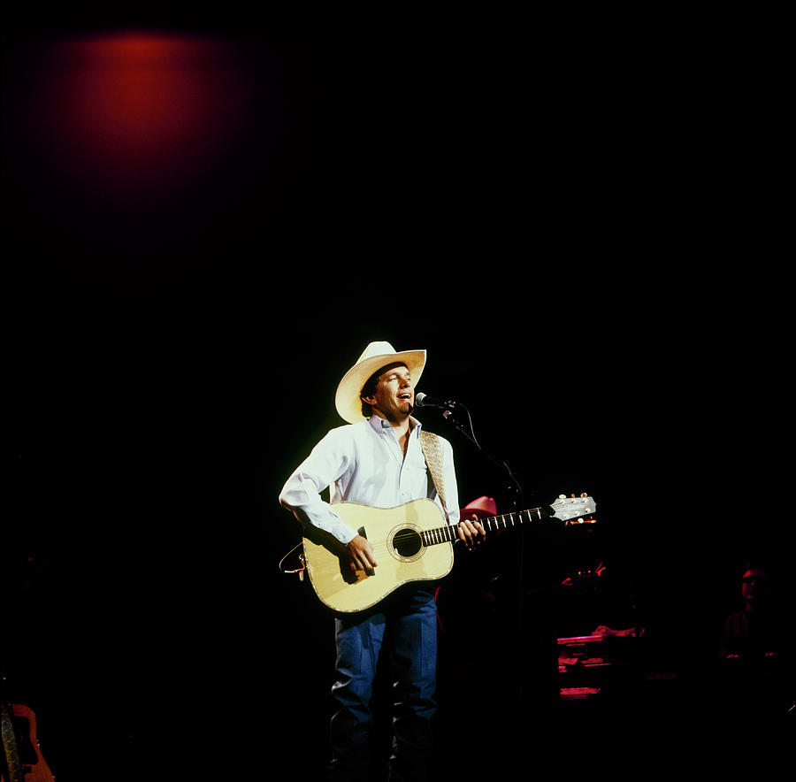 George Strait Perfoms On Stage Photograph by David Redfern