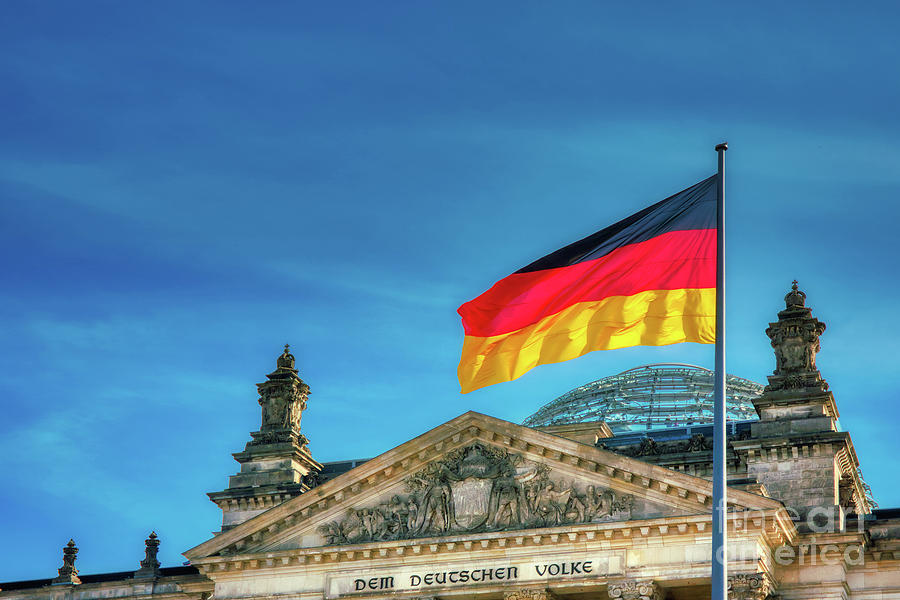Germany Flag Photograph - Germany Flag And Reichstag Building Seat Of The German Parliament by Stefano Senise