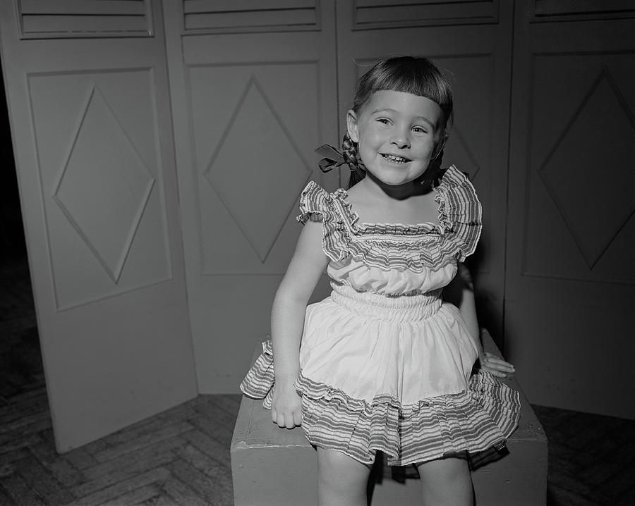 Girl 6-7 Sitting On Box, Smiling Photograph by George Marks