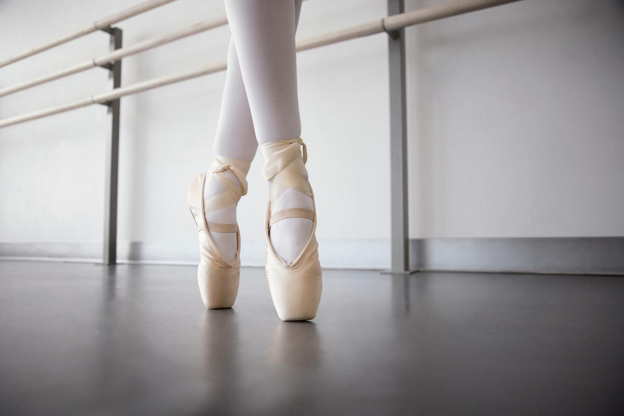 Girl 8-10 Standing On Points In Ballet Photograph by David Sacks