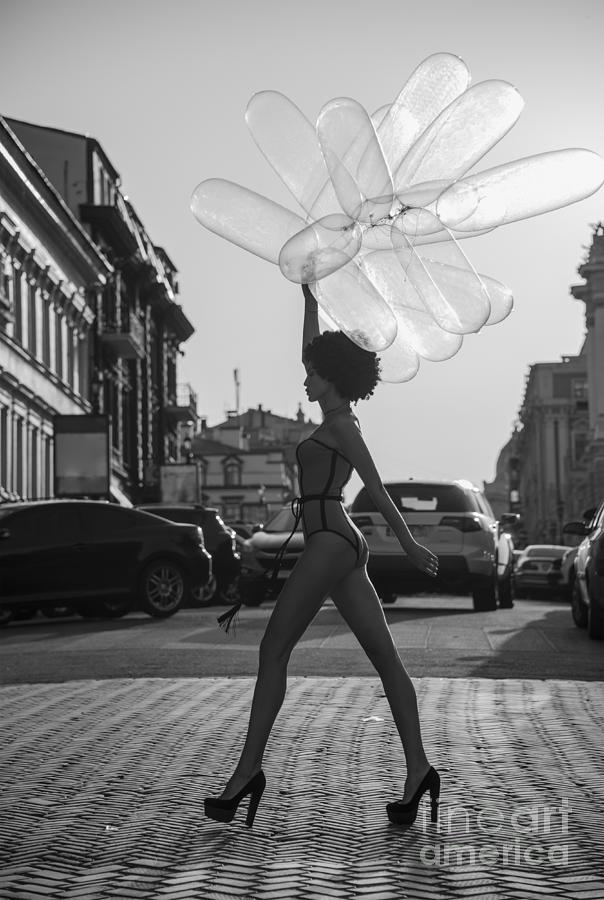 Girl Going Down The Street With Balloons Photograph by Vizerskaya