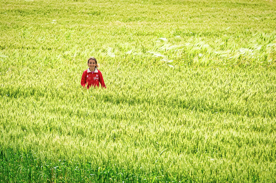 Girl in a Grass Field - Morocco by Stuart Litoff