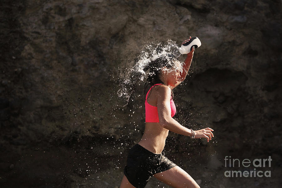 Girl Running And Drenching Herself Photograph by Stanislaw Pytel