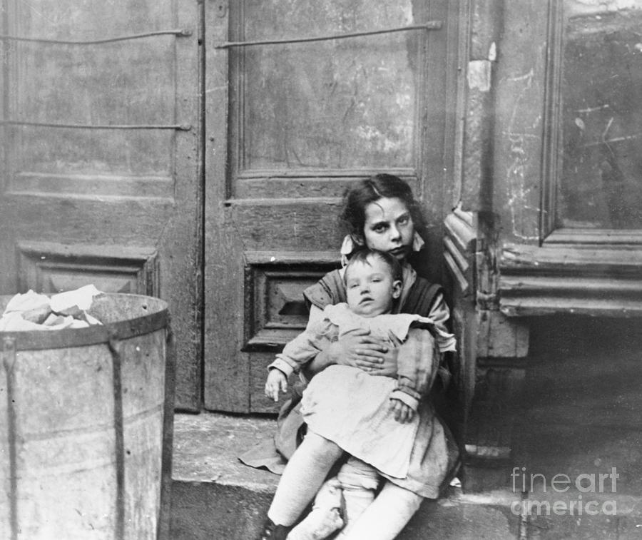 Girl Sitting On Doorstep With Baby Photograph by Bettmann