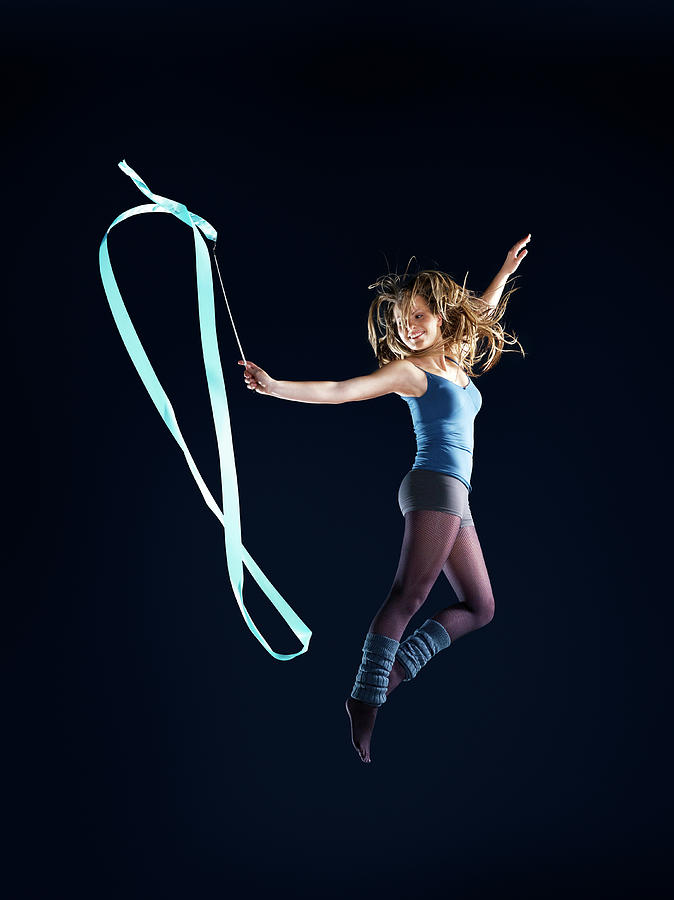 Girl Suspended In Air, Dancing, Jumping Photograph by Jakob Helbig