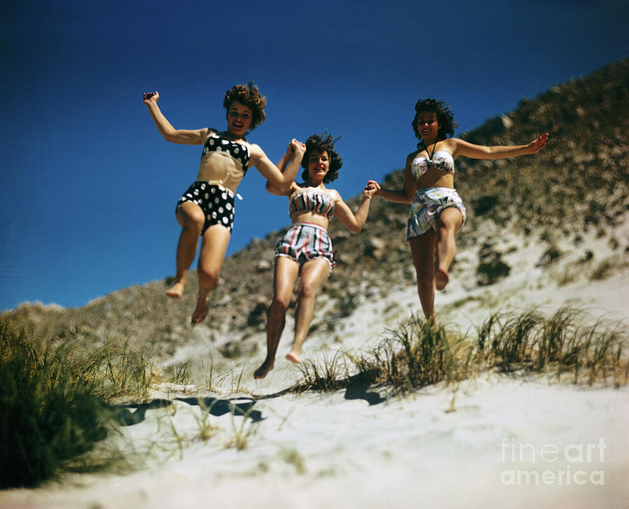 Girls Running On Beach Photograph by Bettmann