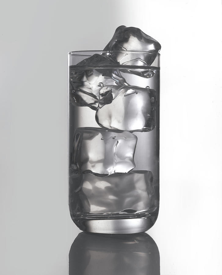 Glass Filled With Water And Ice Photograph by Tom Kelley