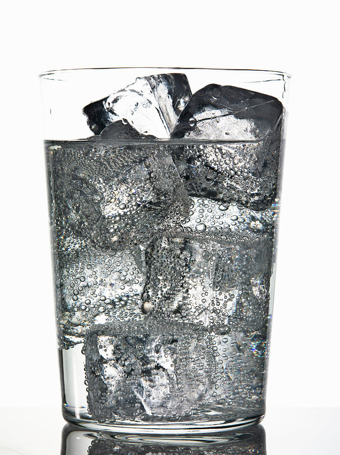 Glass Of Ice Cubes In Fizzy Drink Photograph by Walter Zerla