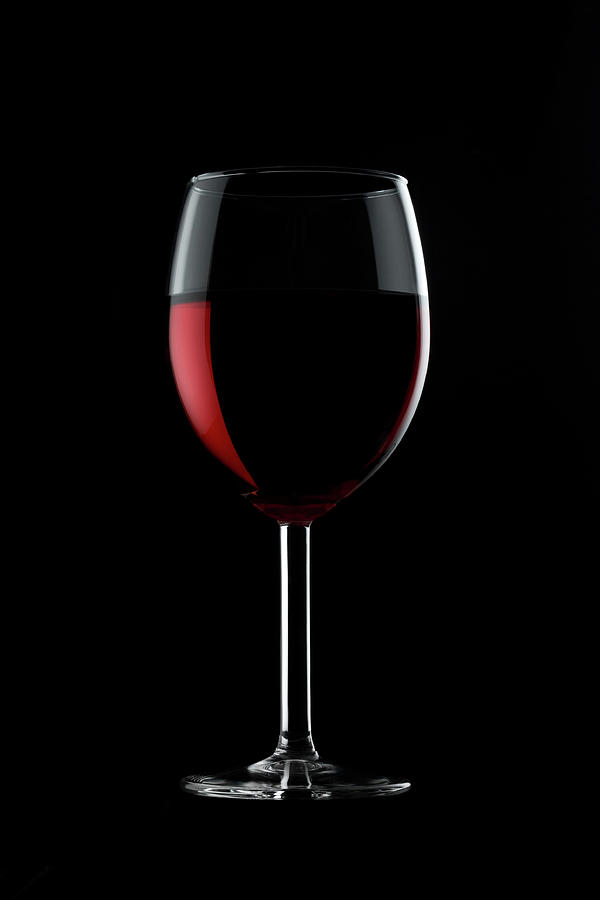 Glass Of Red Wine Against Black Photograph by Mayakova