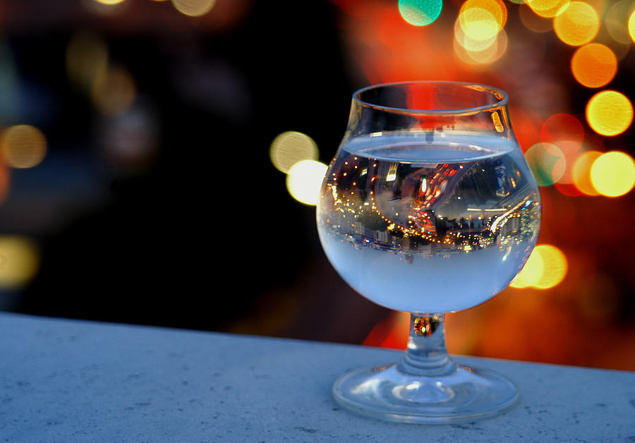 Glass Of Water Overlooking Vienna Photograph