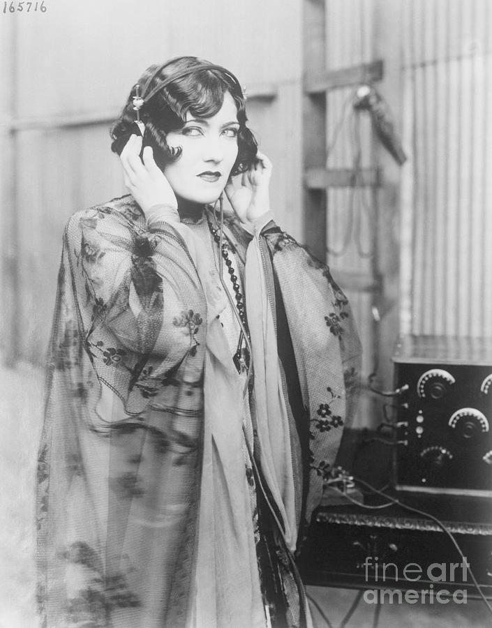 Gloria Swanson Listening To Radio Photograph by Bettmann