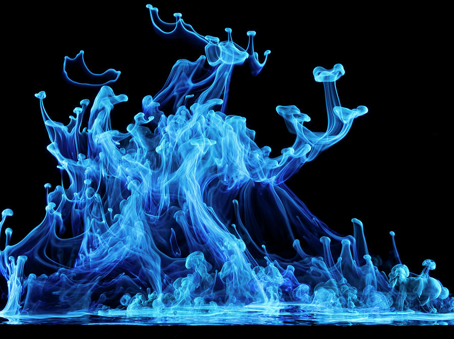Glowing Blue Liquid Photograph by Don Farrall
