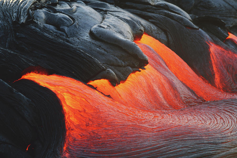 Glowing Streams Of Lava Pouring During Photograph by Paul Souders