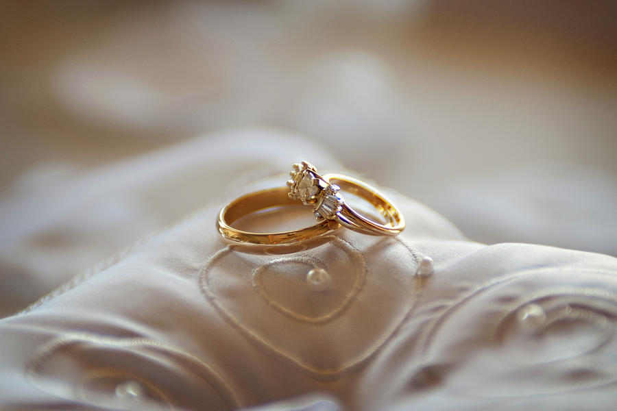 Gold Wedding Rings On A Pillow Photograph by Driendl Group