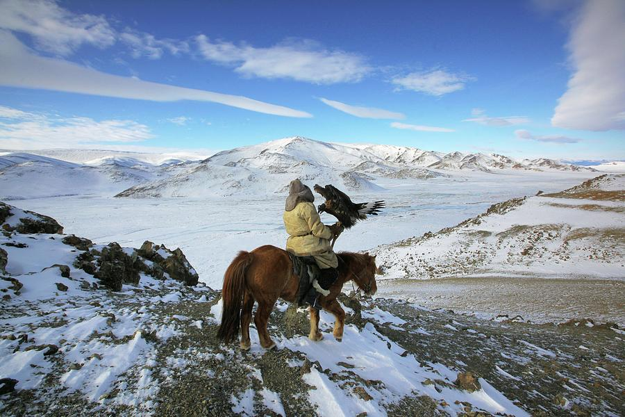 Golden Eagle Hunter Riding In Altai Photograph by Timothy Allen