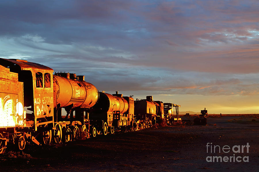Golden Hour At Uyuni Train Cemetery Bolivia by James Brunker
