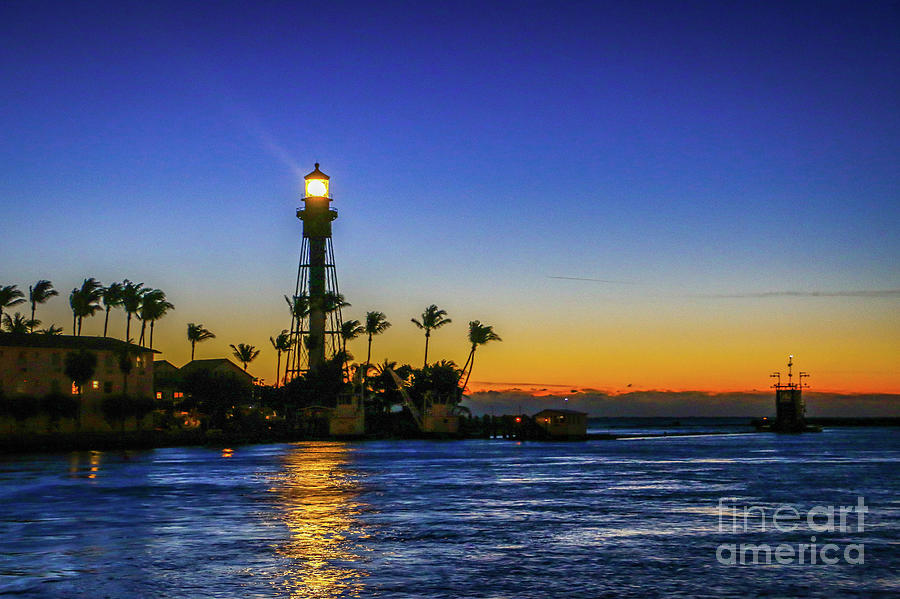 Golden Lighthouse Reflection by Tom Claud