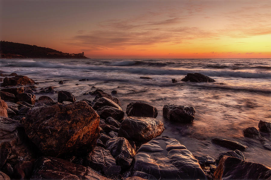 Golden sunset along the coast in Tuscany.  by Matteo Viviani