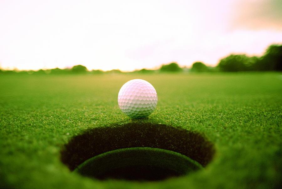 Golf Ball At Edge Of Hole Photograph by Ken Reid