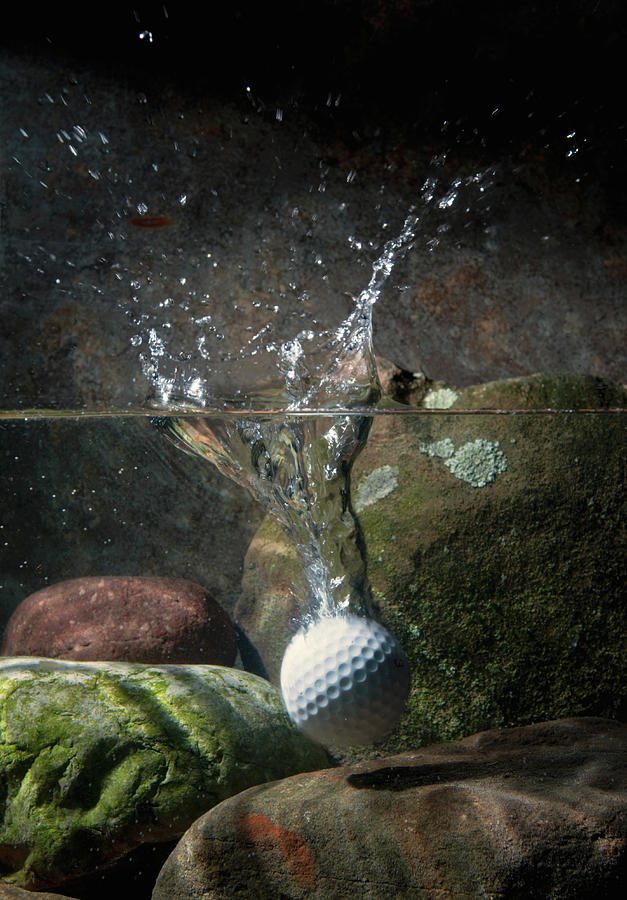Golf Ball Hits Water Hazard Photograph by Pm Images