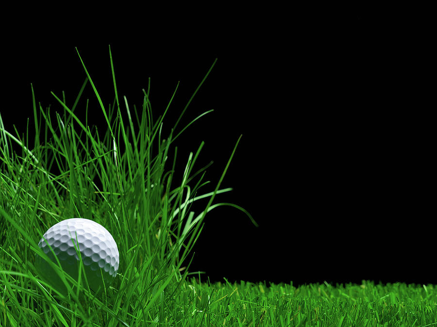Golf Ball Laying In The Rough Grass Photograph by Pier