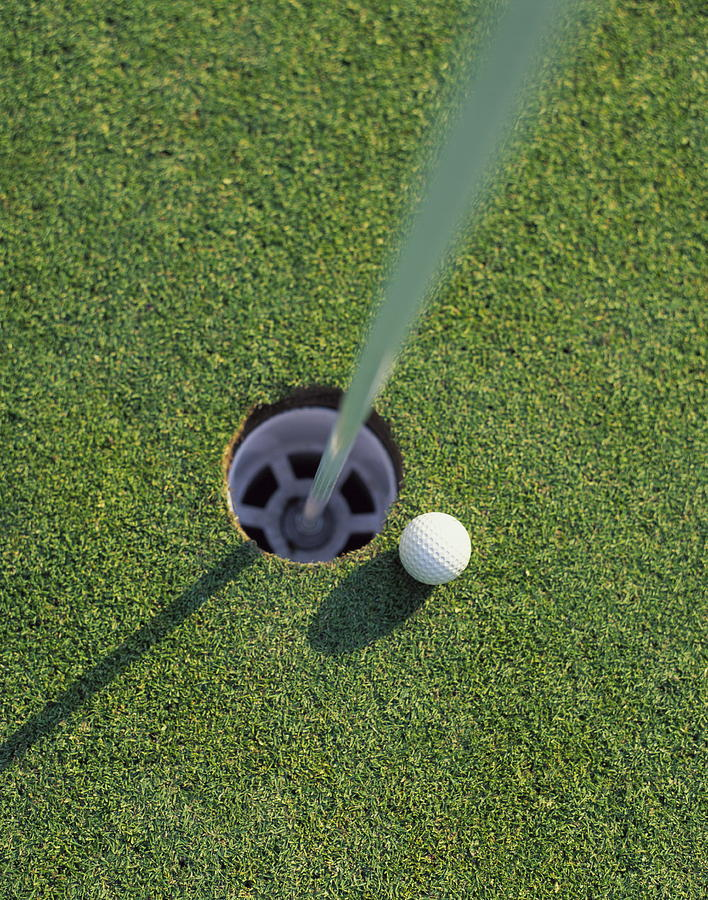Golf Ball Next To Hole On Golf Course Photograph by Peter Gridley