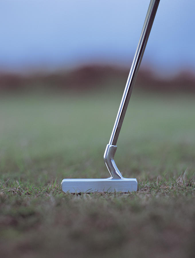 Golf Putter On Rough Grass Photograph by Andy Whale