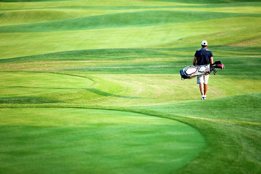 Golfer Photograph by Logosstock
