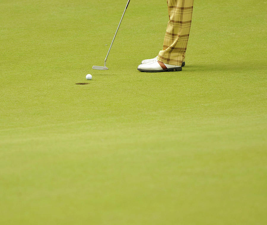 Golfer Putts A Golf Ball Into A Hole Photograph by Photo © Stephen Chung