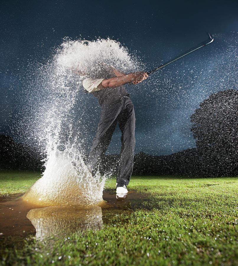 Golfer Spraying Water Photograph by Gallo Images-heinrich Van Den Berg